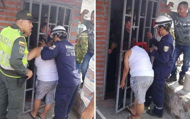 Woman stuck with her head after she wants to peek at the neighbors
