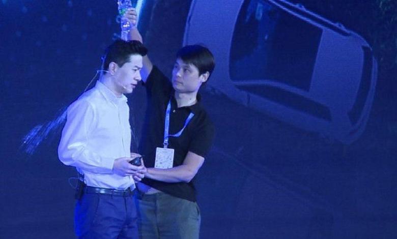 Photo of Man pours water bottle over tech billionaire at presentation