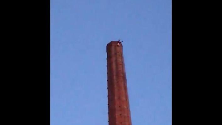 Man died after dangling for hours upside down at a 90m high chimney