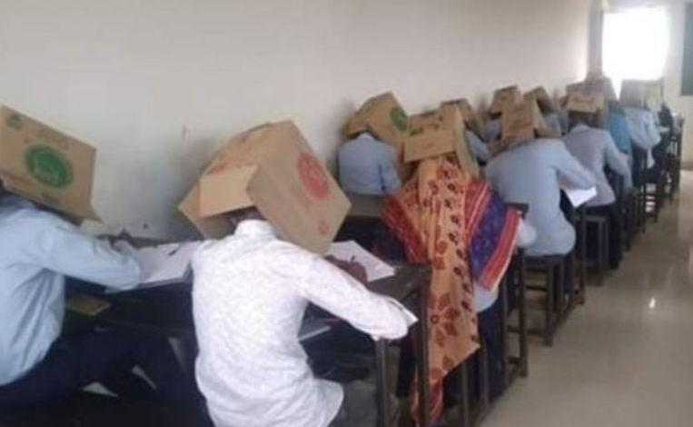 Photo of Students put carton box on the head during the exam