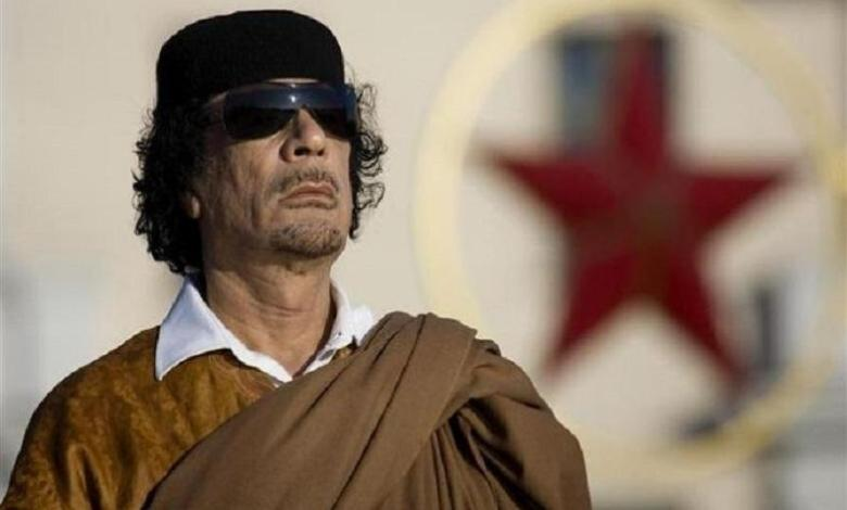 """Photo of """"They will create a virus, pretend and sell the antidotes"""" – Gaddafi"""
