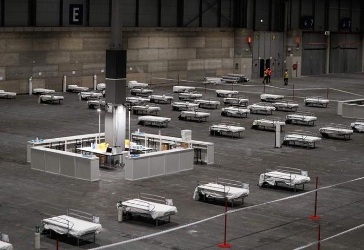 Hundreds of beds have been placed in a conference center in Madrid.