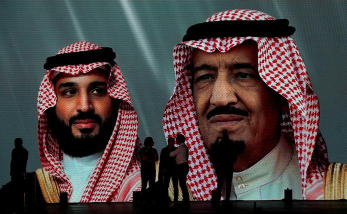 The Saudi king Salman (right) and his son and crown prince Mohammed bin Salman on a giant image in Jeddah, Saudi Arabia