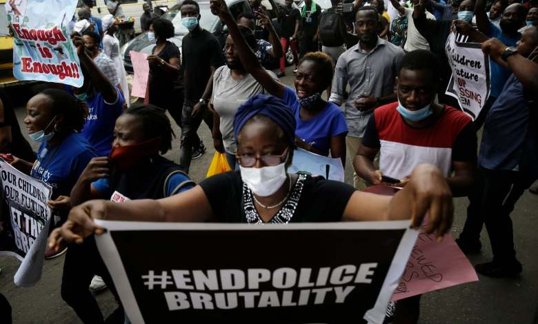 Photo of Nigerians in South Africa says no to the killing of protesters