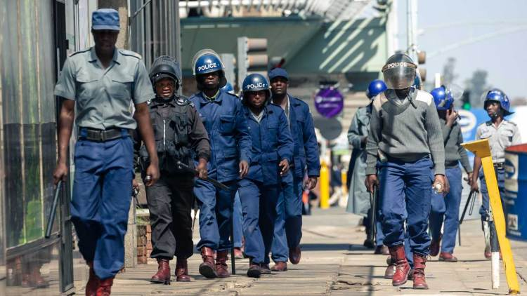 Zimbabwean anti-riot police load civilians onto a truck as they patrol the streets of Harare on August 16, 2019, after the High Court upheld a police ban on protests and march planned by the main opposition party over worsening economic conditions in the country. Riot police in Zimbabwe fire teargas and beat demonstrators on August 16 during a crackdown on opposition supporters who have taken to Harare's streets despite a protest ban. Scores of people gathered in the capital's Africa Unity Square to demonstrate against the country's worsening economy in defiance of the ban, which was upheld by a court on August 16.Jekesai NJIKIZANA / AFP