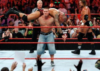 LAS VEGAS - AUGUST 24:  Wrestler John Cena picks up wrestler Randy Orton as wrestler Triple H (R) looks on during the WWE Monday Night Raw show at the Thomas & Mack Center August 24, 2009 in Las Vegas, Nevada.  (Photo by Ethan Miller/Getty Images)