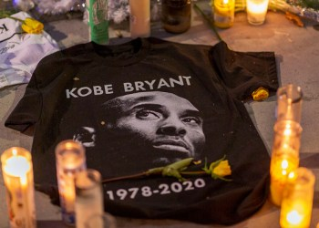 """LOS ANGELES, CA - JANUARY 28: A makeshift memorial is shown near Staples Center in remembrance of former NBA great Kobe Bryant who, along with his 13-year-old daughter Gianna, died January 26 in a helicopter crash, on January 28, 2020 in Los Angeles, California. Kobe and """"Gigi"""" were among nine people killed in the crash in Calabasas, California as they were flying to his Mamba Sports Academy in Thousand Oaks, where he was going to coach her in a tournament game.  (Photo by David McNew/Getty Images)"""