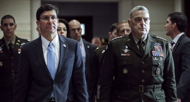(L-R) Secretary of Defense Mark Esper and Chair of the Joint Chiefs of Staff Mark Milley arrive for briefing with members of the U.S. House of Representatives about the situation with Iran, at the U.S. Capitol on January 8, 2020 in Washington, DC. Drew Angerer/Getty Images/AFP