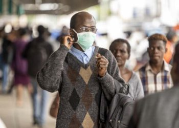 A man walks in the streets wearing a face mask as a preventive measure agaisnt the spread of COVID-19 coronavirus on March 23, 2020, in Bulawayo, Zimbabwe. - On March 23, 2020, Zimbabwe announced a first COVID-19 coronavirus related death. (Photo by ZINYANGE AUNTONY / AFP)