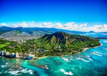 The dormant volcano known as Diamond Head located adjacent to downtown Honlulu, Hawaii, as shot from an altitude of about 1500 feet over the Pacific Ocean. | Image: Getty Images/HawaiiHome