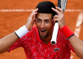 Serbia's Novak Djokovic reacts as he takes part in tennis match during a charity exhibition hosted by him, in Belgrade on June 12, 2020. – Novak Djokovic has also tested positive for coronavirus on June 23, 2020 along with Grigor Dimitrov, Borna Coric and Viktor Troicki, after taking part in an exhibition tennis tournament in the Balkans featuring world number one Novak Djokovic, raising questions over the sport's planned return in August. (Photo by Andrej ISAKOVIC / AFP)