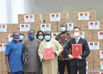 Chairman of Ghana's ruling New Patriotic Party Frederick Armah Blay (3rd R) poses for a photo with other officials during a handover ceremony of medical supplies in Accra, Ghana, on July 27, 2020. The International Department of the Central Committee of the Communist Party of China (CPC) presented a consignment of medical supplies to Ghana's ruling New Patriotic Party (NPP) here on Monday. (Xinhua/Xu Zheng)