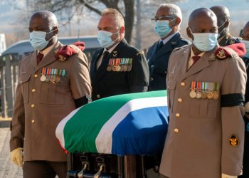 Pallbearers carry the coffin of South African anti-apartheid figure Andrew Mlangeni during the funeral service in Soweto, South Africa, on July 29, 2020. - Mlangeni, 95, was the last surviving Rivonia trialist, spending more than quarter of a century imprisoned on Cape Town's notorious Robben island before his release in 1989. (Photo by Jerome Delay / POOL / AFP)
