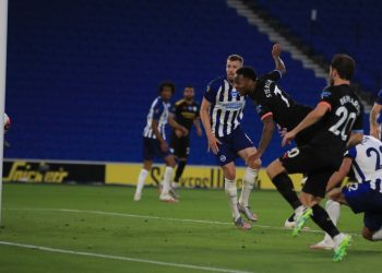Manchester City's English midfielder Raheem Sterling scores the third goal during the English Premier League football match between Brighton and Hove Albion and Manchester City at the American Express Community Stadium in Brighton, southern England on July 11, 2020. (Photo by Adam Davy / POOL / AFP)
