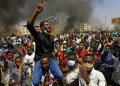 Sudanese demonstrators gesture as they chant during a protest on Sixty street in the east of the capital Khartoum, on June 30, 2020. ASHRAF SHAZLY / AFP