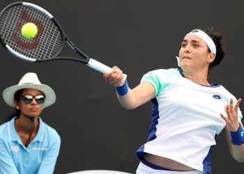 Tunisia's Ons Jabeur hits a return against France's Caroline Garcia during their women's singles match on day three of the Australian Open tennis tournament in Melbourne on January 22, 2020. (Photo by DAVID GRAY / AFP) / IMAGE RESTRICTED TO EDITORIAL USE - STRICTLY NO COMMERCIAL USE (Photo by DAVID GRAY/AFP via Getty Images)