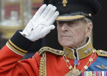 (FILES) In this file photo taken on June 16, 2012, Britain's Prince Philip, Duke of Edinburgh salutes as he watches the troops ride past outside Buckingham Palace following the Queen's Birthday Parade, 'Trooping the Colour' at Horse Guards Parade in London . – Queen Elizabeth II's 99-year-old husband, Prince Philip, has been moved back to a private hospital to recuperate from a heart procedure at a specialist cardiac unit, Buckingham Palace said on March 5, 2021. (Photo by LEON NEAL / AFP)