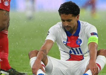 Paris Saint-Germain's Brazilian defender Marquinhos sits injured just after scoring the 0-2 goal and has to go off during the UEFA Champions League quarter-final first leg football match between FC Bayern Munich and Paris Saint-Germain (PSG) in Munich, southern Germany, on April 7, 2021. (Photo by Christof STACHE / AFP)