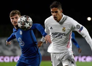 Chelsea's German forward Timo Werner (L) vies with Real Madrid's French defender Raphael Varane during the UEFA Champions League semi-final first leg football match between Real Madrid and Chelsea at the Alfredo di Stefano stadium in Valdebebas, on the outskirts of Madrid, on April 27, 2021. (Photo by PIERRE-PHILIPPE MARCOU / AFP)