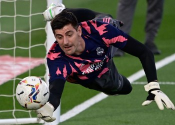 Real Madrid's Belgian goalkeeper Thibaut Courtois warms up before the Spanish League football match between Real Madrid and Osasuna at the Alfredo Di Stefano stadium in Valdebebas in the outskirts of Madrid on May 1, 2021. (Photo by JAVIER SORIANO / AFP)