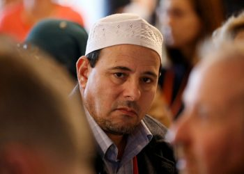 Gamal Fouda, the Imam of the Al Noor Mosque, attends the first day of the country's first annual hui (gathering) on countering terrorism and violent extremism in Christchurch Town Hall on June 15, 2021. (Photo by Sanka VIDANAGAMA / AFP)