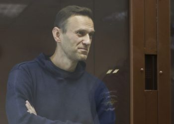 Russian opposition leader Alexei Navalny, charged with defaming a World War II veteran, stands inside a glass cell during a court hearing in Moscow on February 5, 2021. (Photo by Handout / Moscow's Babushkinsky district court press service / AFP) /
