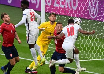 England's forward Raheem Sterling (R) scores the opening goal during the UEFA EURO 2020 Group D football match between Czech Republic and England at Wembley Stadium in London on June 22, 2021. (Photo by NEIL HALL / POOL / AFP)