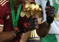 CAIRO, EGYPT - JULY 19: Goalkeeper Rais M'Bolhi Ouhab holds the trophy as Algerian team celebrate championship after the 2019 Africa Cup of Nations final match between Senegal and Algeria at the Cairo Stadium in Cairo, Egypt on July 19, 2019. Algeria won their first Africa Cup of Nations (AFCON) title in 29 years, beating Senegal 1-0 late Friday in Egypt.    (Photo by Fared Kotb/Anadolu Agency/Getty Images)