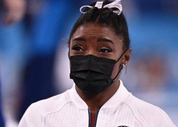 USA's Simone Biles is seen prior to compete in the vault event of the artistic gymnastics women's team final during the Tokyo 2020 Olympic Games at the Ariake Gymnastics Centre in Tokyo on July 27, 2021. (Photo by Lionel BONAVENTURE / AFP)