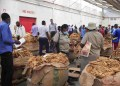 Workers of the tobacco auction floors inspect bales of tobacco in Harare, Zimbabwe, on April 7, 2021. (Xinhua/Shaun Jusa)