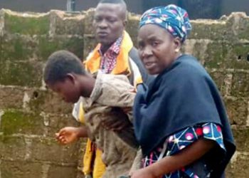 One of the released 28 students of Bethel Baptist High School, who were kidnapped by bandits on July 5, reunite with his parent at the school premises in Kaduna …yesterday.
