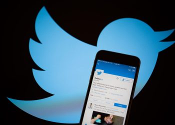 The Twitter Inc. logo is seen behind an Apple Inc. Photographer: Michael Nagle/Bloomberg via Getty Images