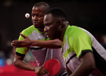 Nigeria's Tajudeen Agunbiade (L) serves beside teammate Alabi Olufemi during the men's table tennis team quarter-final (classes 9-10) at the Tokyo 2020 Paralympic Games at Tokyo Metropolitan Gymnasium in Tokyo on August 31, 2021. (Photo by Yasuyoshi CHIBA / AFP)