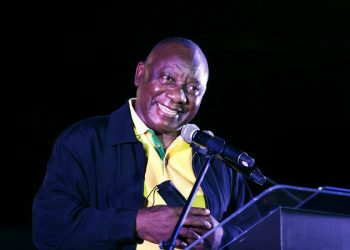 South Africa and African National Congress (ANC) president, Cyril Ramaphosa smiles as he addresses supporters during the party's manifesto launch for the upcoming local government elections at the Church Square in Pretoria, on September 27, 2021. (Photo by Phill Magakoe / AFP)