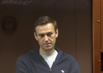 (FILES) This handout file photograph handout provided by the Babushkinsky district court on February 12, 2021, shows Russian opposition leader Alexei Navalny, charged with defaming a World War II veteran, standing inside a glass cell during a court hearing in Moscow. – Russian prison officials are threatening to start force-feeding jailed Kremlin critic Alexei Navalny, his team said on April 12, 2021, after he lost eight kilograms (18 pounds) since starting a hunger strike. (Photo by Handout / Moscow's Babushkinsky district court press service / AFP) /