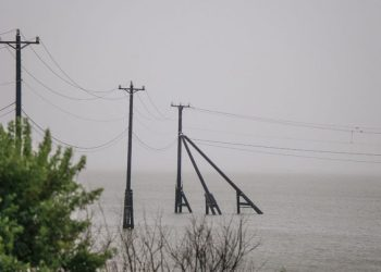 GALVESTON, TEXAS – SEPTEMBER 13: Transmission towers are shown ahead of the Tropical Storm Nicholas on September 13, 2021 in Galveston, Texas. A hurricane watch is in effect as Tropical Storm Nicholas is expected to make landfall later this evening. Parts of the Texas Gulf Coast, southwestern Louisiana, and Mexico may see up to 20 inches of rain with Nicholas bringing life-threatening storm surges, isolated tornadoes and projected tropical-storm winds of up to 115mph. Brandon Bell/Getty Images/AFP (Photo by Brandon Bell / GETTY IMAGES NORTH AMERICA / Getty Images via AFP)