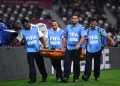 DOHA, QATAR - DECEMBER 17: Ali Ben Romdhan of Esperance Sportive de Tunis is taken off on a stretcher following an injury during the FIFA Club World Cup 2019 5th place match between Al-Saad Sports Club and Esperance Sportive de Tunis at Khalifa International Stadium on December 17, 2019 in Doha, Qatar. (Photo by David Ramos - FIFA/FIFA via Getty Images)