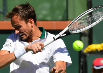 Daniil Medvedev of Russia hits a forehand return to Grigor Dimitrov of Bulgaria in their Round of 16 match at the Indian Wells tennis tournament on October 13, 2021 in Indian Wells, California. (Photo by Frederic J. BROWN / AFP)