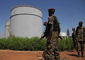 South Sudanese soldiers guard near an oil refinery in Melut, Upper Nile State, on November 20, 2012. PHOTO | HANNAH MCNEISH | AFP