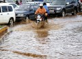KAMPALA, UGANDA - DECEMBER 13: Motorcycles pass through water in a street after torrential rains in Kampala, Uganda on December 13, 2016. (Photo by Lubowa Abubaker/Anadolu Agency/Getty Images)