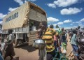 KULUBA, UGANDA - 2018/05/08: A South Sudanese single mother carrying her baby as she arrives at the Kuluba Refugee reception center in border region between South Sudan and Uganda on 8th May 2018. She was still holding on to her 2 metal containers which she used for cooking to feed herself and her baby while she was hiding in the forest in South Sudan before finding a chance to cross into Uganda. The Kuluba refugee reception center is one of many reception centers in northern Uganda specially built to handle the hundreds of thousand of South Sudanese refugees influx. The reception center is where refugees are being registered by the UNHCR as refugees officially and they are only going to be staying here for 24-48 hours before being transferred to more permanent refugee settlements. (Photo by Geovien So/SOPA Images/LightRocket via Getty Images)