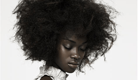 Dark skinned black woman accepting ourselves
