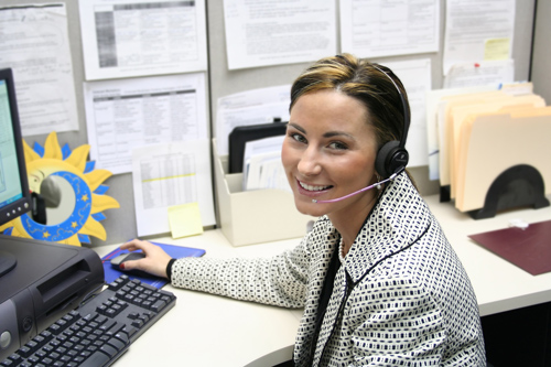 Office Worker with headset for follow up calls