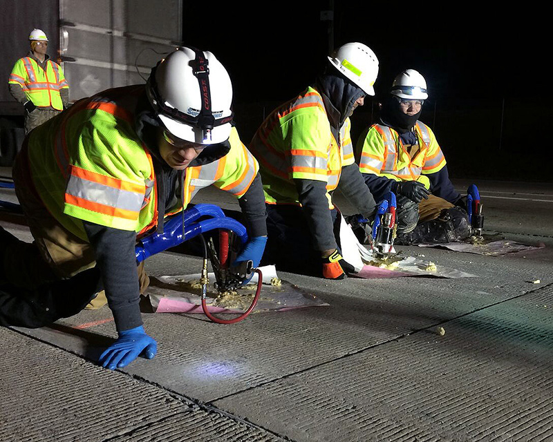 AFS crew members hard at work using our Settle Stop Concrete Raising system