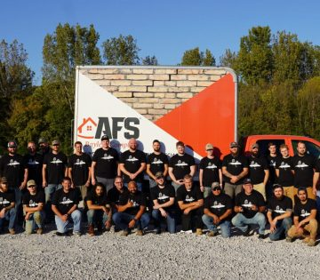 AFS employees in front of truck
