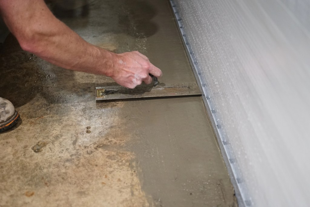 Smoothing over basement drain