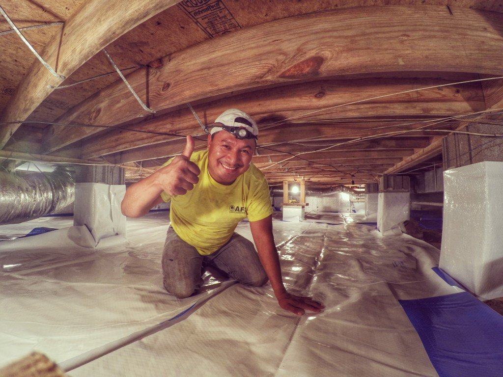 AFS Crew in Crawl Space giving thumbs up