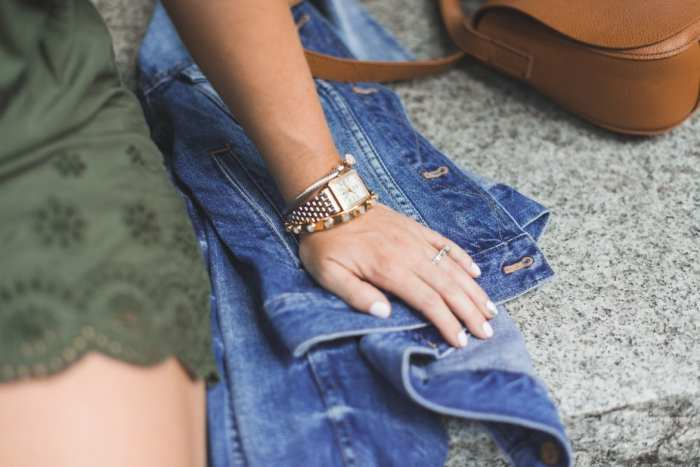 Blogger, Ashley Pletcher from Afternoon Espresso wearing a classic Michele Deco Diamond watch carrying around her Madewell denim jacket to add a layer her to summer look.