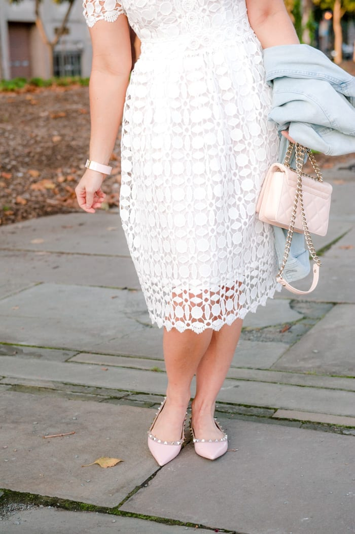 Blogger Ashley Pletcher accessorizes her date night look with pink Valentino look-a-likes and a Kate Spade bag.