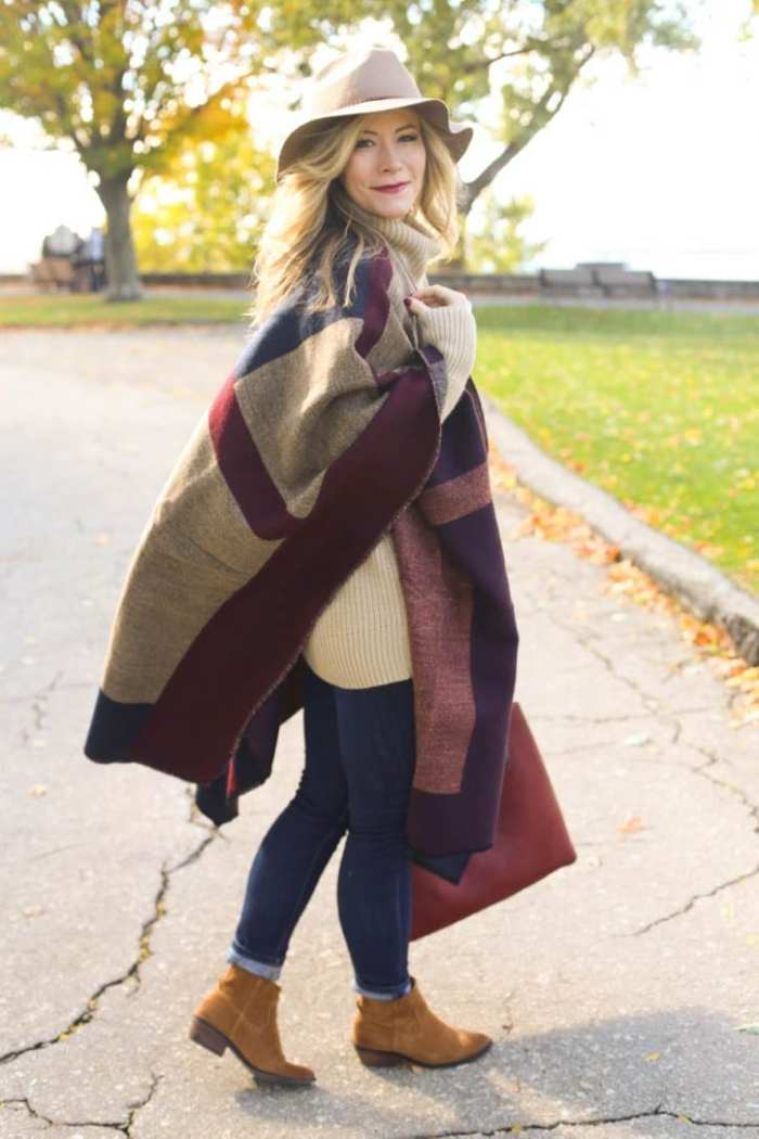 Blogger, Ashley Pletcher, loves layering her Fall look with a cozy cape and a floppy hat.
